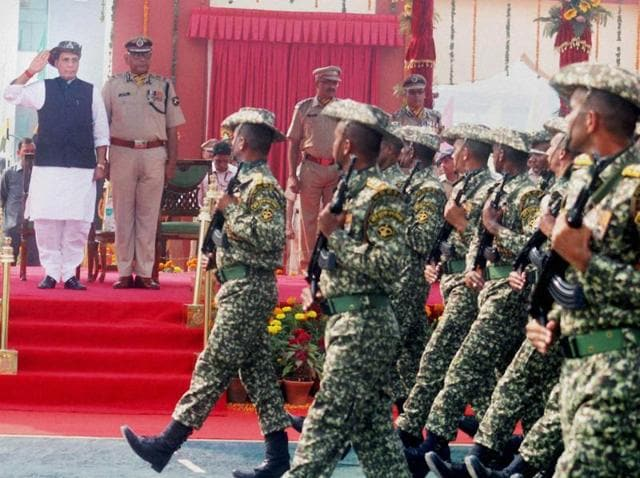 Union home minister Rajnath Singh takes salute at the 55th Raising Day Parade of the force in Greater Noida.