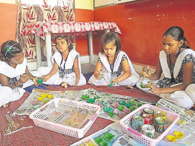 Differently abled girls design earthen lamps with natural colours in Betul.