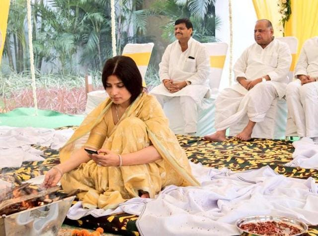 Kannauj MP and UP CM Akhilesh Yadav's wife Dimple Yadav performs grah pravesh puja for the new permanent government house  of the CM on October 9, 2016. Mulayam Singh Yadav, Shivpal Yadav and Akhilesh Yadav are seated behind.