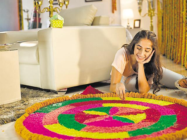 Choose a suitable niche somewhere near the entrance and create something eye-catching such as this rangoli using flowers and plants this Diwali.
