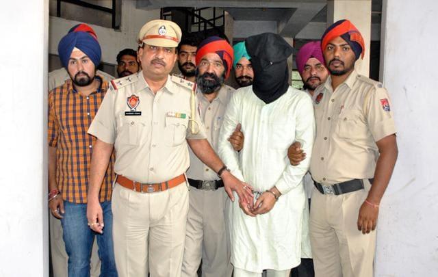Gun smuggler in police custody on Thursday.(HT Photo)