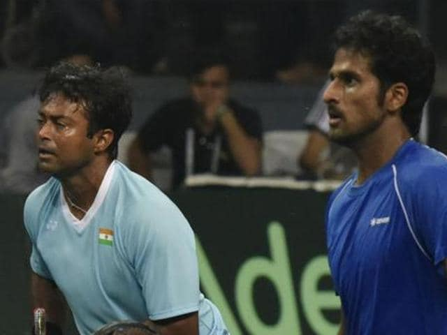India's Leander Paes, left, celebrates a point with teammate Saketh Myneni during the Davis Cup world group play-off against Spain.