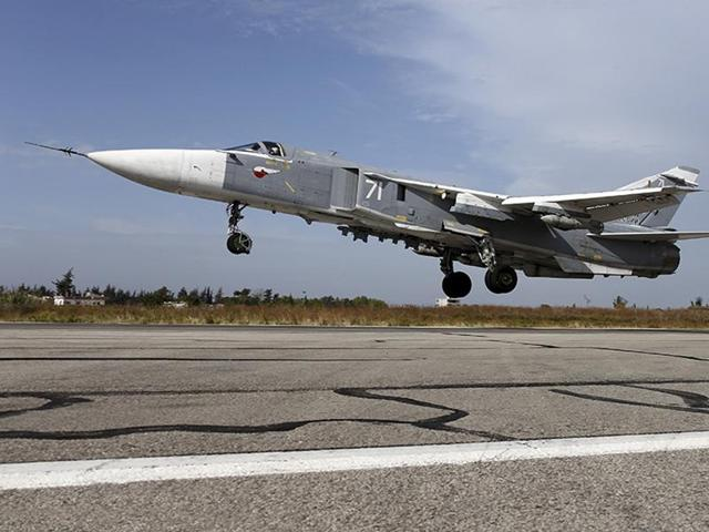 A Sukhoi Su-24 fighter jet takes off from the Hmeymim air base near Latakia, Syria.