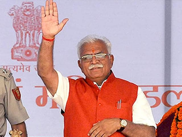 Haryana chief minister Manohar Lal Khattar waves to crowd.