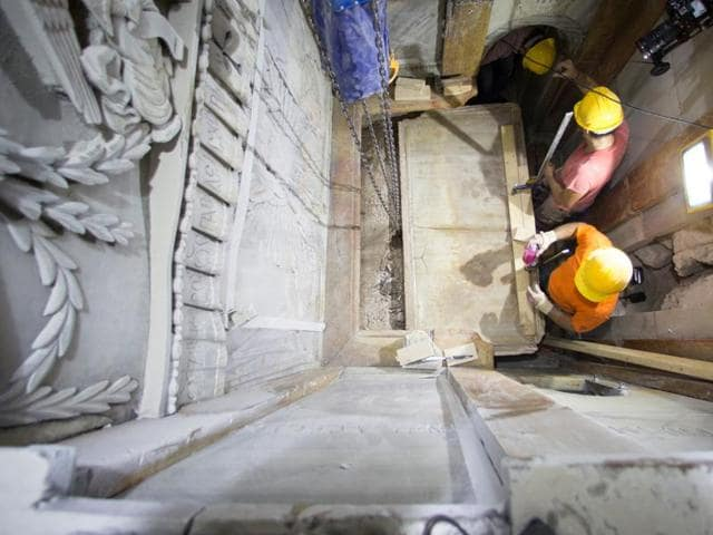 A restoration team has peeled away a marble layer for the first time in centuries in an effort to reach what it believes is the original rock surface where Jesus' body was laid.