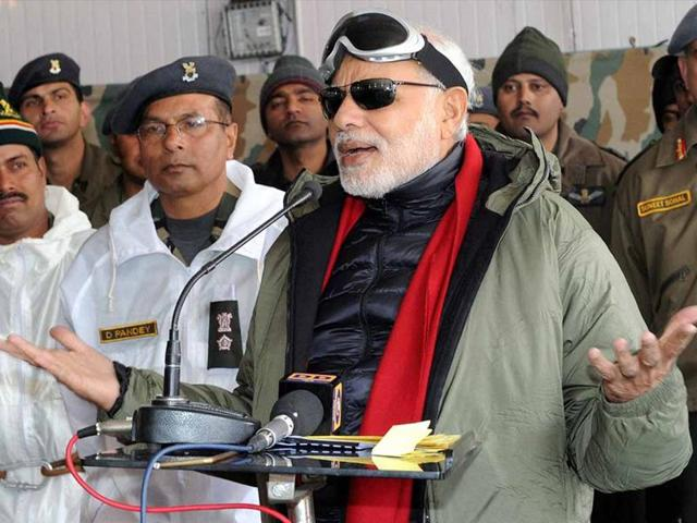 File photo of Prime Minister Narendra Modi sharing sweets with the officers and jawans of Indian Armed Forces during his visit to Siachen on the occasion of Diwali in 2014. (PTI photo)