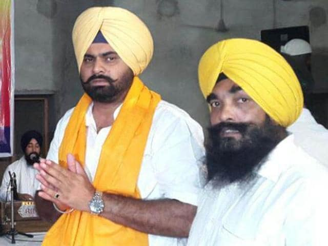Congress district unit president Sukhpal Singh Bhullar (left) after being honoured by Sikh radical leader Manjit Singh at a function at Jhabhal village in Tarn Taran to pay homage to Indira Gandhi's assassins on Thursday night.