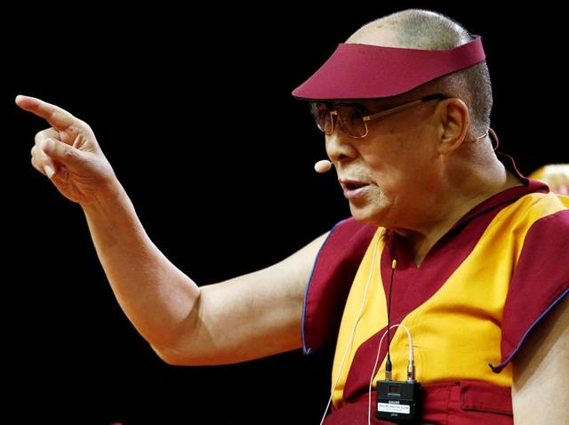 Tibet's exiled spiritual leader the Dalai Lama gestures during a teaching event in Milan, Italy.(REUTERS)