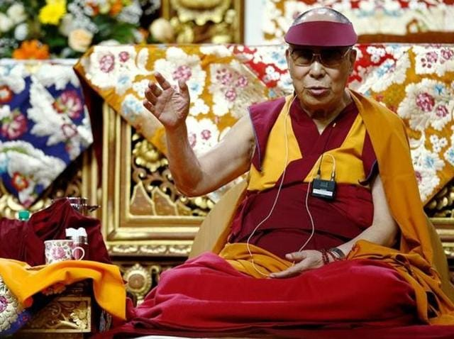 Tibet's exiled spiritual leader the Dalai Lama gestures during a teaching event in Milan, Italy.