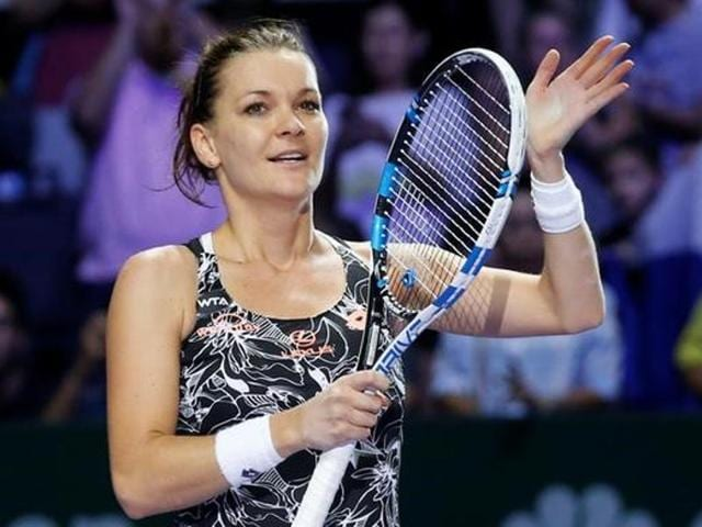 Agnieszka Radwanska of Poland celebrates after beating Karolina Pliskova of the Czech Republic.