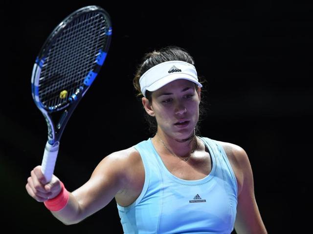 Garbine Muguruza of Spain in action against Svetlana Kuznetsova of Russia.