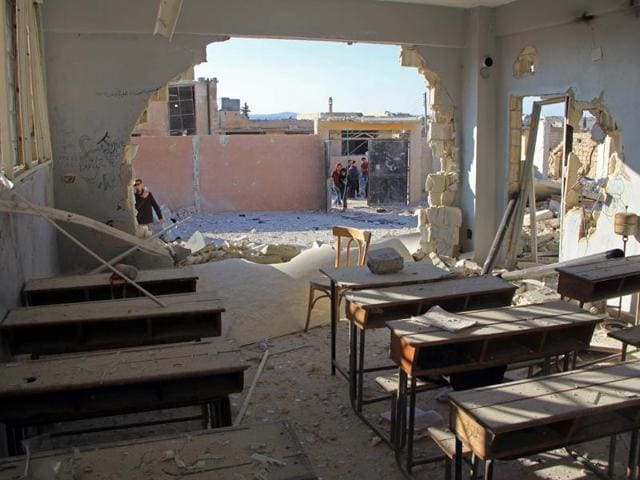 A general view shows a damaged classroom at a school after it was hit in an air strike in the village of Hass, in the south of Syria's rebel-held Idlib province.(Omar haj Kadour/AFP)