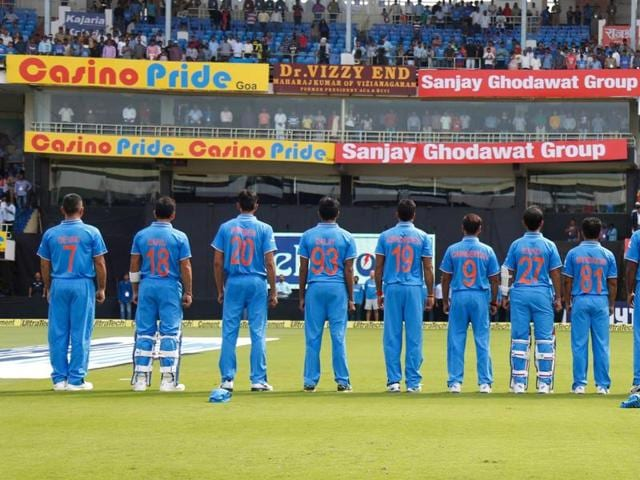 The Indian team with their mother's names on their jerseys.