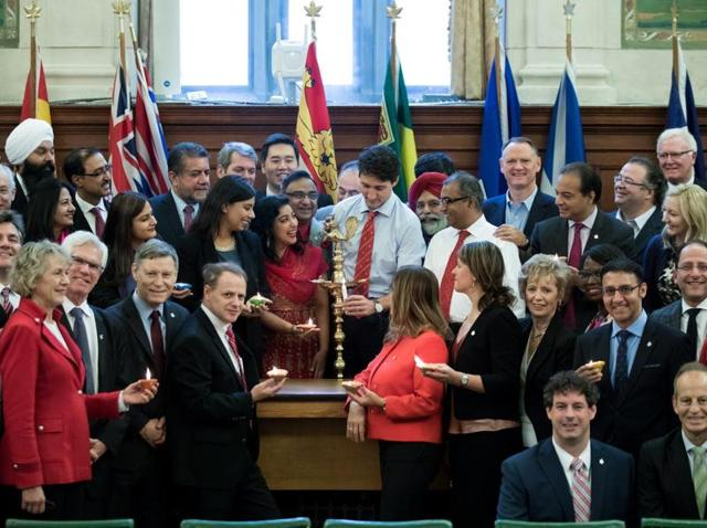 Canadian Prime Minister Justin Trudeau lighting a Diwali lamp during a national caucus meeting at the Parliament in Ottawa last week.