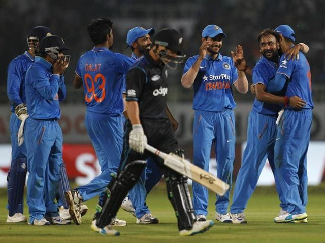 India's Amit Mishra, second right, celebrates with teammates after taking the wicket of New Zealand's BJ Watling.