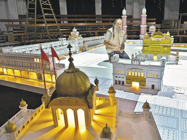 Superviser Amardeep Behl with a Golden Temple Plaza 3D project model in Amritsar on Friday.