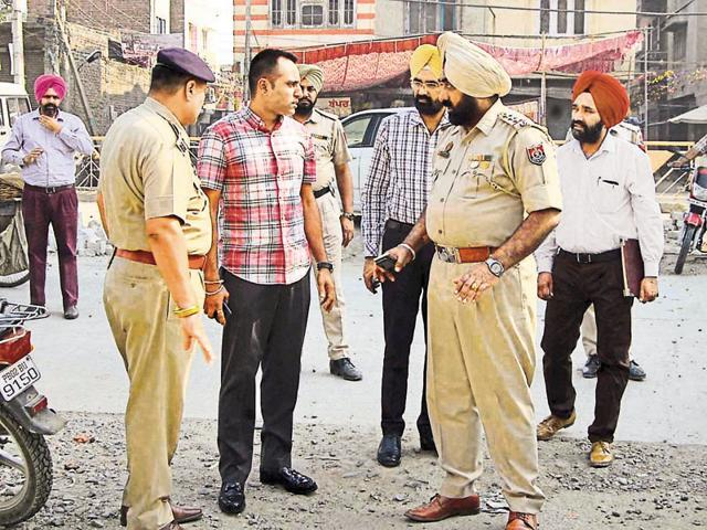 Police officials at the crime spot on Batala road area in Amritsar on Friday.