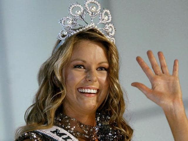 In this June 2004 file photo, Miss Australia Jennifer Hawkins celebrates as she was crowned Miss Universe, at a convention centre in Quito, Ecuador.