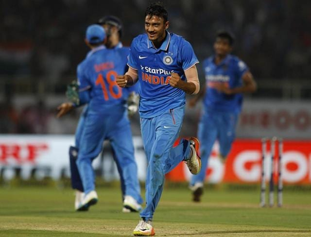 Indian Captain M S Dhoni, Virat Kohli and Amit Mishra celebrate after their victory over New Zealand.