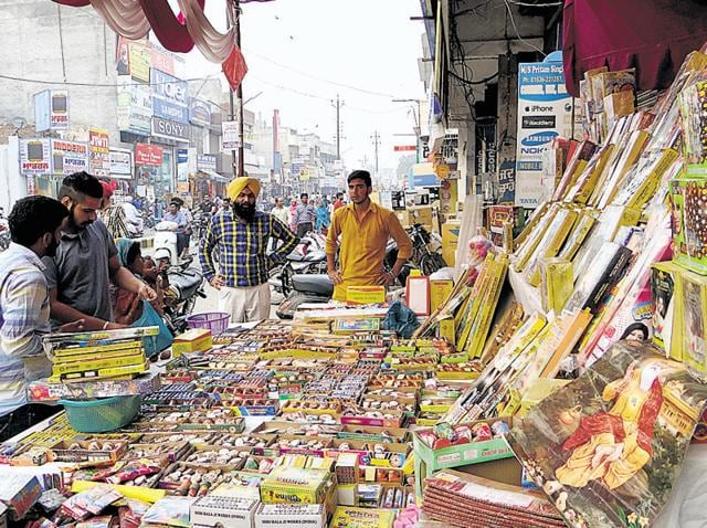 People purchasing firecrackers at a market in Moga on Friday.