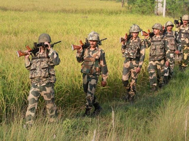 Border Security Force men carry out a vigil near the International Border in RS Pura Sector in Jammu.