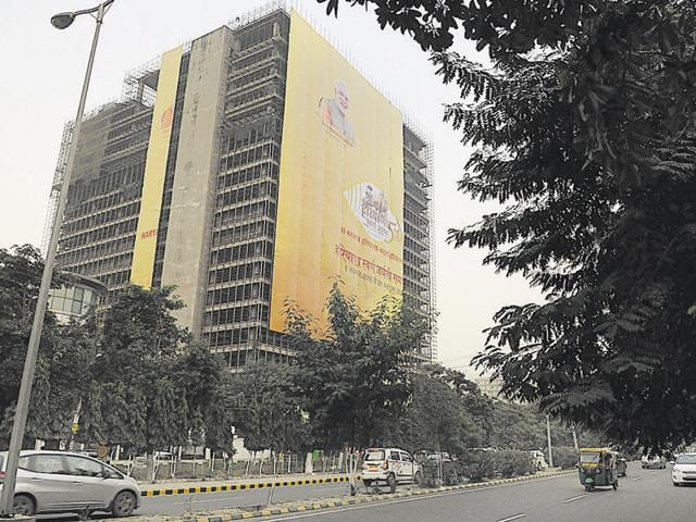 Haryana government has installed a large banner of Prime Minister Narendra Modi on an under construction building in the city ahead of the golden jubilee celebrations that start on November 1.
