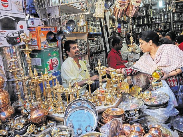 Women buy utensils at a Bhopal shop on the occasion of Dhanteras on Friday.