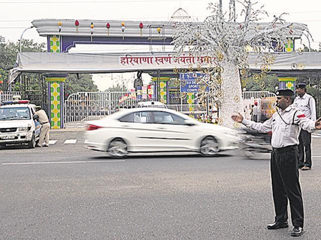 Traffic constable manage traffic in front of VVIPs entry gate at the Tau Devi Lal Stadium on Friday.