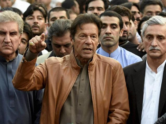 Supporters of Pakistani opposition leader Imran Khan chant anti-government slogans outside Khan's