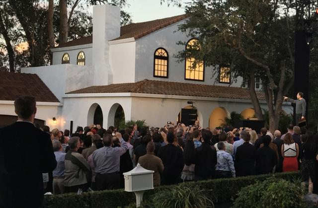 Tesla's electric car, Powerwall and solar roof are shown in Los Angeles, California, on Friday.