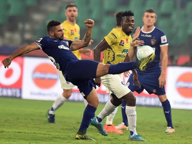 Chennaiyin FC (in Blue jersey) and Kerala Blasters FC (Yellow jersey) vie for the ball.