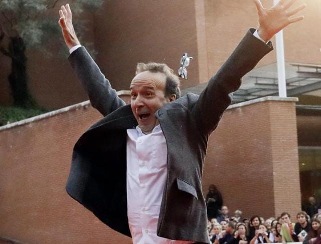 Roberto Benigni poses for photographers as he arrives on the red carpet at the Rome Film Festival.