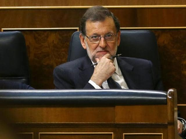 Spain's acting Prime Minister Mariano Rajoy after a debate at Parliament in Madrid on Thursday. Rajoy is likely to be confirmed as prime minister in a parliamentary confidence vote on Saturday.(Reuters)