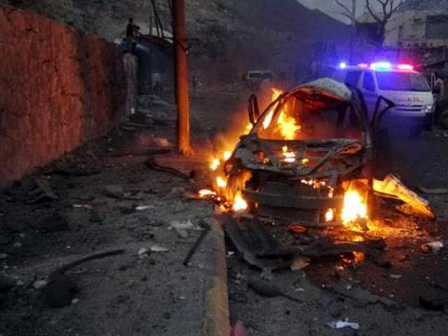 This file photo from January 17, 2016 shows a  car burning at the site of a car bomb attack outside the house of the director of security for Yemen's southern port city of Aden.