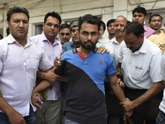 Alleged Pakistani spy Shoaib Hussain in police custody on Friday. Three Indians, all hailing from Rajasthan, were arrested for allegedly passing on information about border deployment.