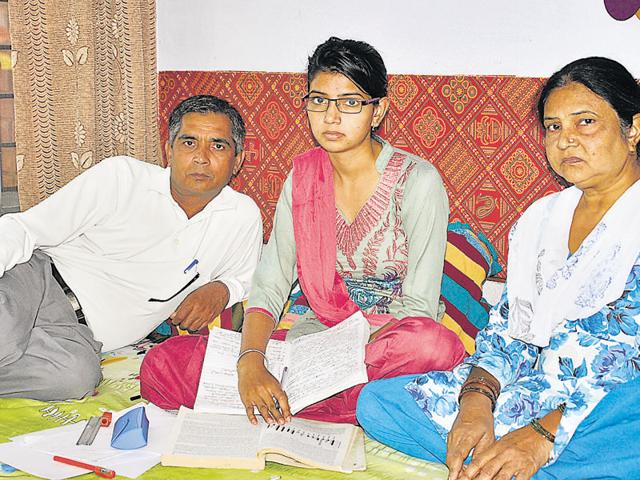 Ram Bir with his family at HMT Colony in Pinjore.