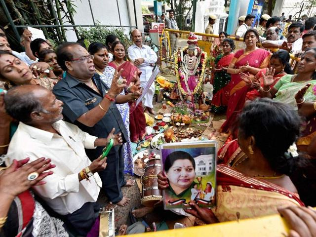 AIADMK members offer special prayers for speedy recovery of chief minister J Jayalalithaa, in front of Apollo Hospital in Chennai on Tuesday.