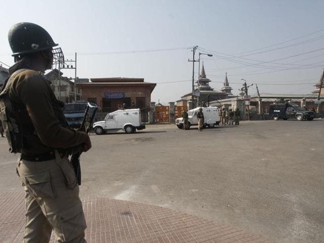 A paramilitary soldier stands guard near the Jamia Mosque during curfew in downtown area of Srinagar.