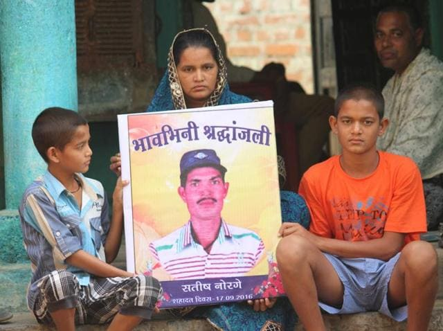 Santosh Norge's two sons—Rahul and Prakash --- and his wife Usha Devi in Sagarpara village in Champa district's Janjgir . Satish's death has become a rallying point for Dalits in Chhattisgarh.