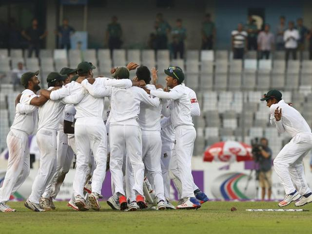 Bangladesh players huddle to celebrate after securing their first-ever Test win against England on Sunday.