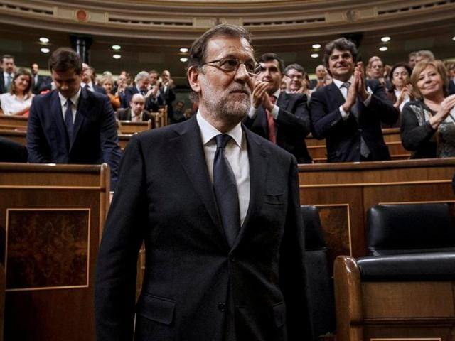 Newly re-elected Spanish Prime Minister Mariano Rajoy (centre) is applauded by fellow party deputies at Parliament in Madrid, Spain.