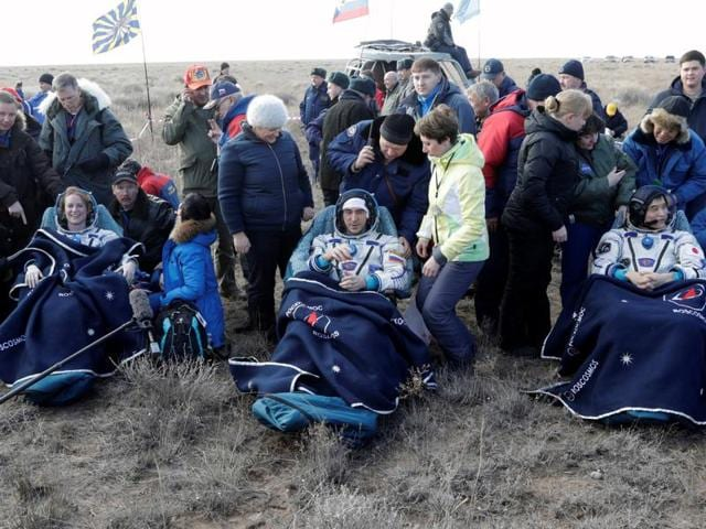 Russian space agency rescue team helps International Space Station (ISS) crew member Anatoly Ivanishin of Russia to get from the capsule shortly after the landing of the Russian Soyuz MS space capsule.