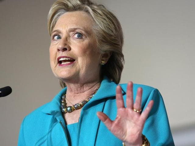 Democratic presidential candidate Hillary Clinton comments on the latest developments with the FBI and an investigation into her emails, during a campaign rally at the Dickerson Community Centre in Daytona Beach.