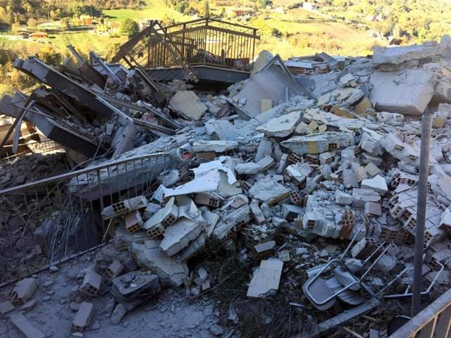 Rubble of a collapsed building in L'Aquila, central Italy, after an earthquake with a preliminary magnitude of 6.6 struck on Sunday.