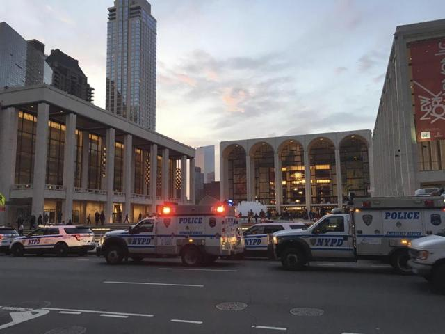 Police respond to New York's Metropolitan Opera that had halted a performance after someone sprinkled an unknown powder into the orchestra pit.