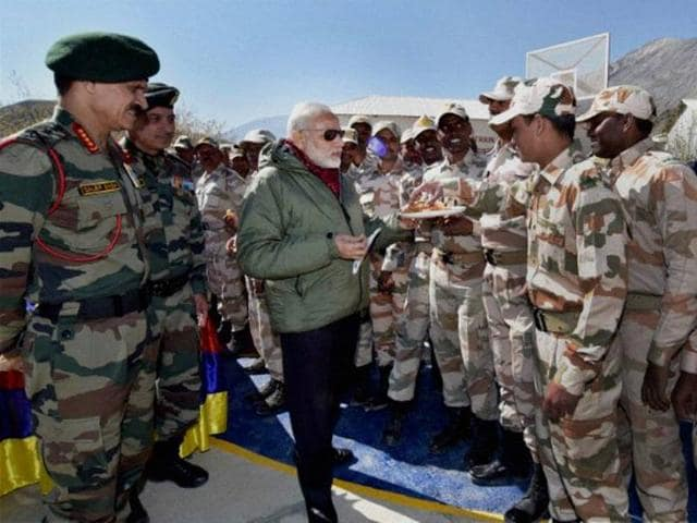 Prime Minister Narendra Modi offers sweets to jawans on the occasion of Diwali at Sumdo in Himachal Pradesh.