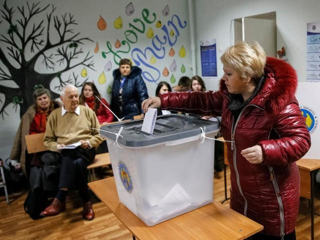 A woman casts a ballot during a presidential election at a polling station in Chisinau, Moldova.