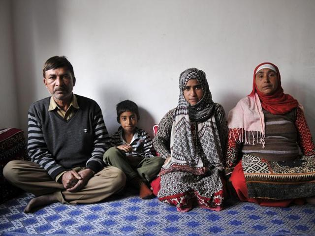 Family members of Danish Sultan Haroo at their house in Palpora area of Srinagar. Danish was killed after he jumped into the Jhelum to escape from security forces during a clash on September 1.