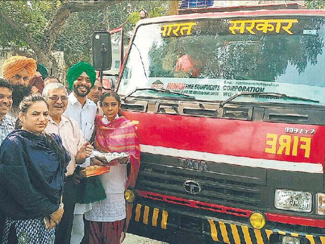 Patiala MP Dr Dharamvira Gandhi handing over the fire tender to MC officials in Nabha on Saturday.