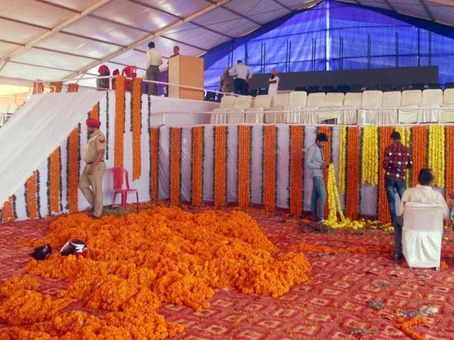 Workers give the final touches to the stage for the rally to mark Punjabi suba's 50th anniversary, at Ranjit Avenue, Amritsar, on Monday.
